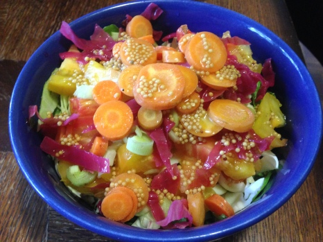 Salads are back!  We topped this one with colorful sauerkraut and carrot pickles made earlier in the season--the more toppings, the better!