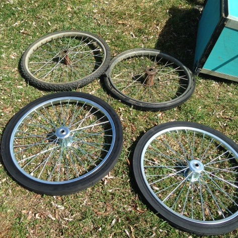 The old set and the flashy new set of wheels for the garden cart
